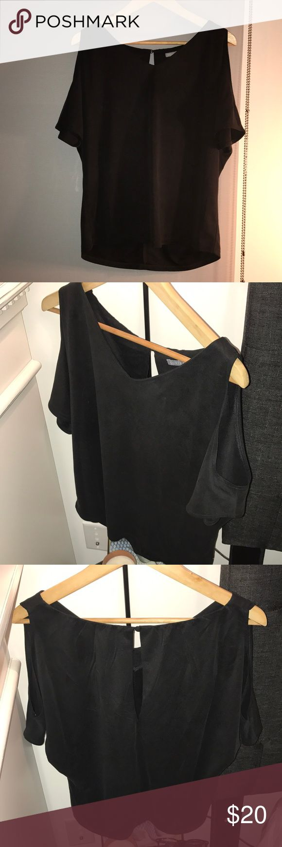 Super soft open shoulder black lounge top Bought this too in the U.K. 🇬🇧 it's a size 8, which is equivalent to a size 4 in the US. Worn only once, goes great with jeans, leggings... pretty much anything! Can dress up with a long necklace, or dress down with shorts (white are super cute for summer) Bought from a boutique in the U.K. Called Oliver Bonas. Oliver Bonas Tops Blouses