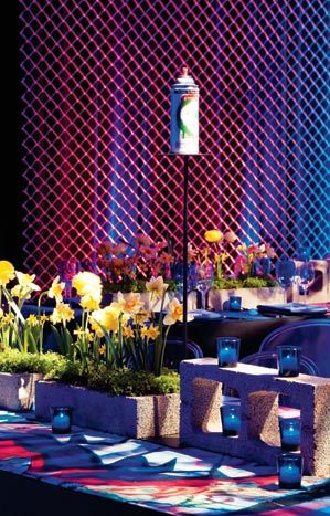 The tables at a graffiti-themed bar mitzvah designed by David Stark Design and Production, held at Center 548 in New York, displayed arrangements of daffodils and ranunculuses sprouting from cinder block planters.  Photo: Susan Montagna