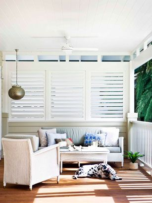 Plantation shutters on the porch for shade