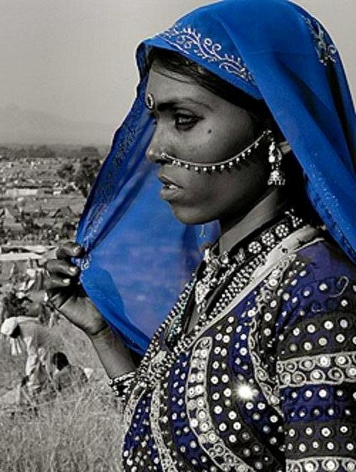 Papu is a gypsy in Rajasthan, India - the home of the original gypsies. She is a local celebrity having been photographed many times by photographers from all over the world. She makes some extra cash in that way, but anywhere else she'd be making serious money as a model. Her photo appears on many sites including one devoted almost entirely to her. It was set up to raise money for dowry victims.