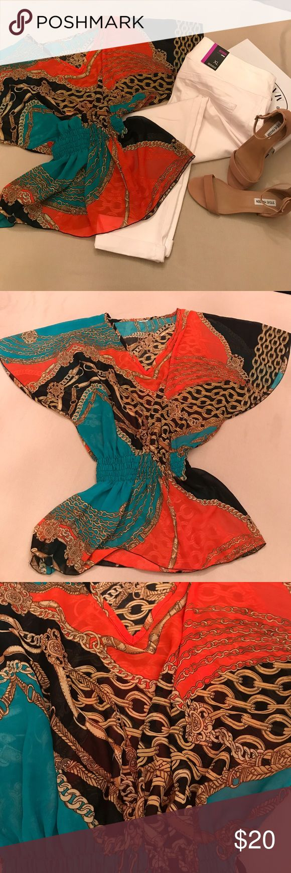 Woman's flutter sleeve Flutter sleeve, v neck, smocked waist woman's top Turquoise, orange, black with a chain pattern running throughout the top. Tops Blouses
