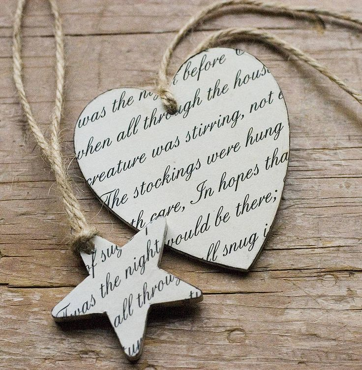 wooden christmas decorations featuring words from the seasonal classic The Night Before Christmas.Made from  solid birch wood and covered in a printed fabric design which has been inked around the edges to give a aged appearance. Each decoration is hung with jute twine.  Heart Size: 8cm x 7.5cm  Star Size: 157cm