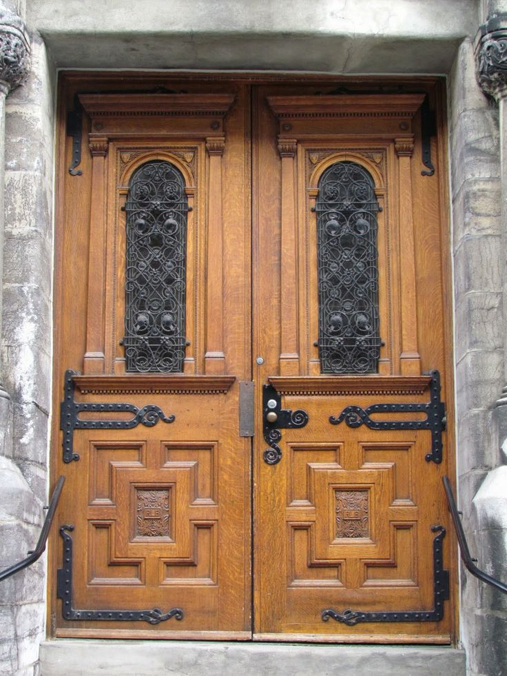These heavy wooden 19th century doors are on the campus of McGill University in Montreal, Canada