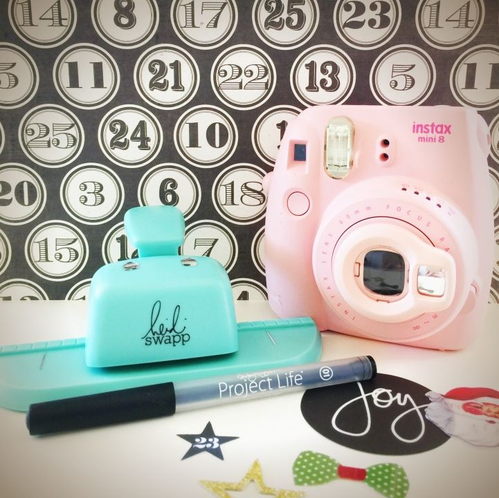 A pink Instax camera plus the Heidi Swapp Memory Dex hole punch -- a cute collection from jot Girl Lauren Hender.