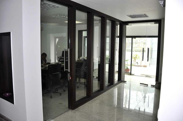 The Corridor Contains Office Cabins And Meeting Spaces On
