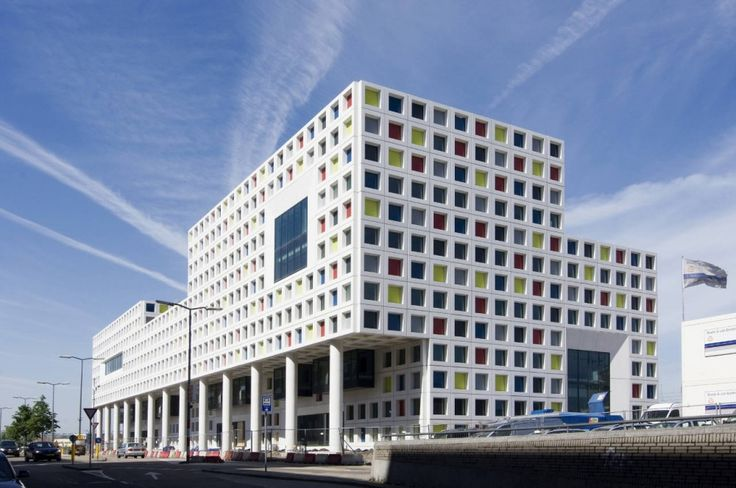School building with concrete facade made from colored glass elements in The Hague. Read more at http://ow.ly/lO4pf via Archdaily.com