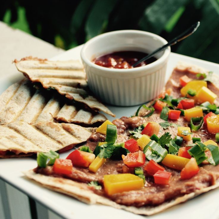 Spicy Refried Bean and Mango Quesadillas. We eat these often and it's our go to meal when we have to make something super tasty in minutes. The perfect combination of sweet and spicy!