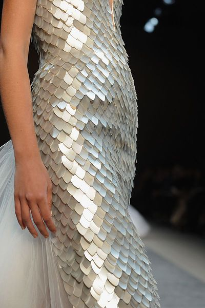 Dress with fish scale textures in a pearl finish - textured surface embellishment; fashion details // Georges Chakra