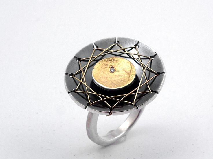 The web. A statement round gold and oxidized silver ring with a diamond and a distinctive design that refers to halloween. by TomisCraft on Etsy