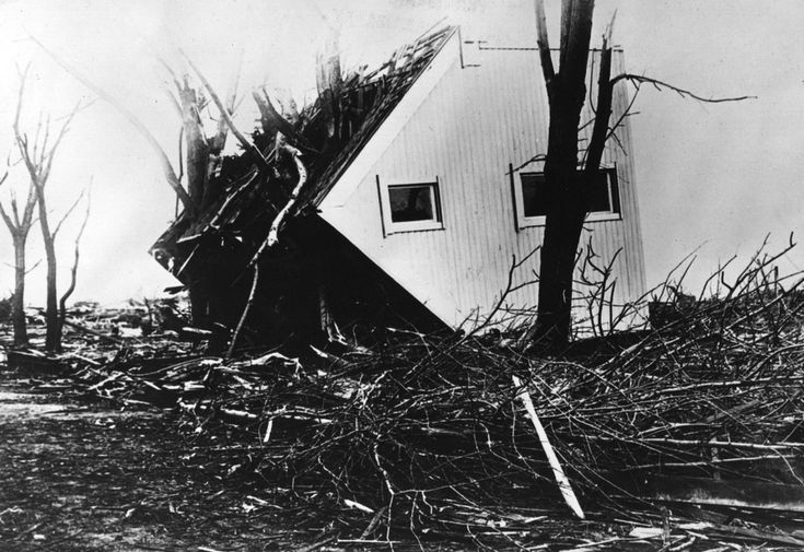 A toppled house which was carried more than 50ft in the great US cyclone disaster of 1925