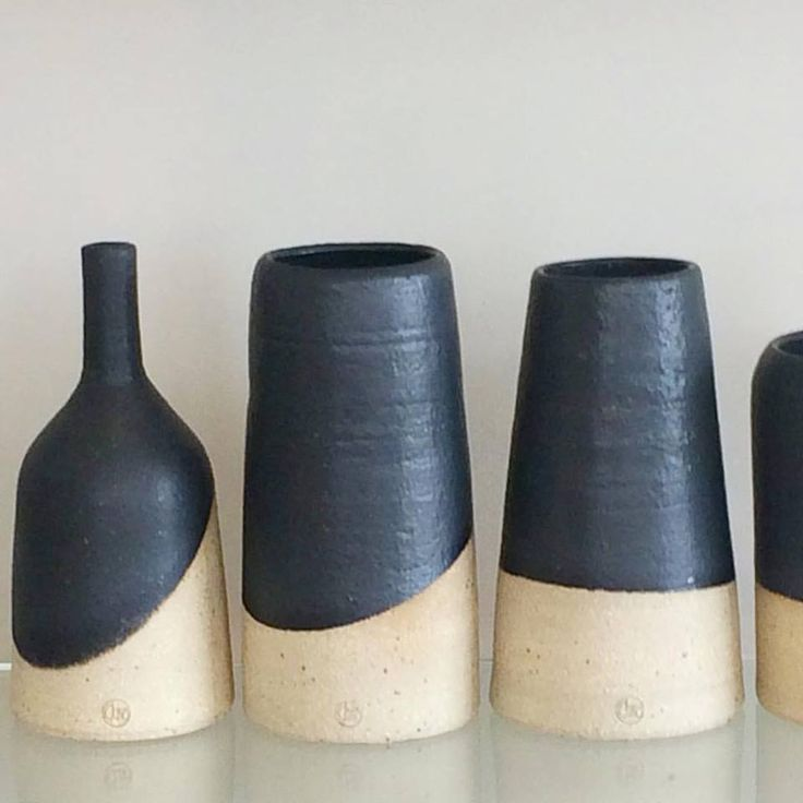 Half dipped stoneware vases by Penelope Duke. Now in store.