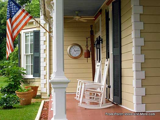 A beautifully decorated front porch. Love the clock on the wall. From PorchIdeas.com #porch