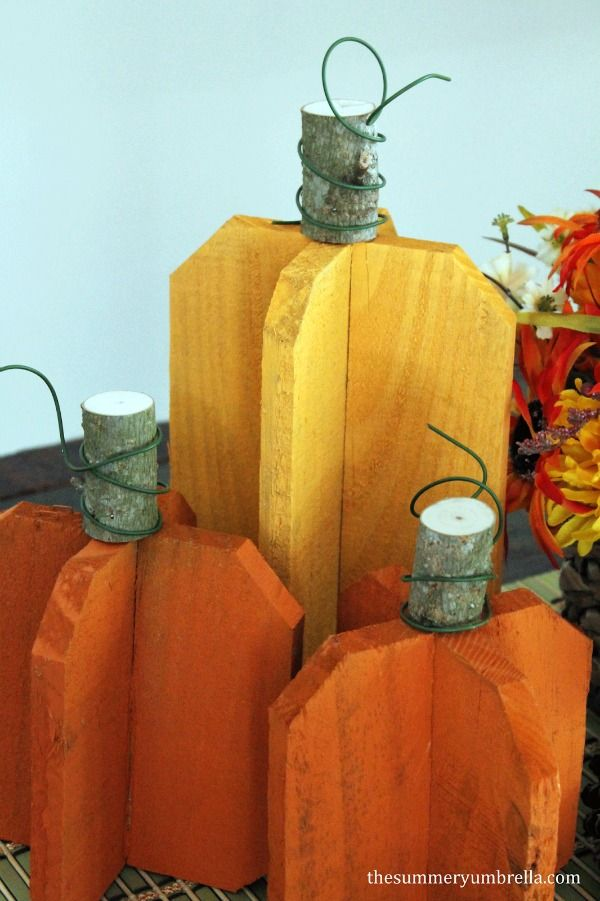 These adorable, rustic pumpkins for fall were made from pieces of scrap wood! Check out the tutorial to make your own!