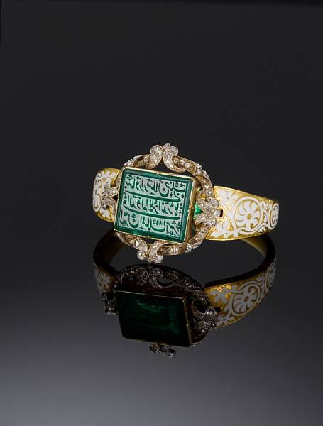 An important Mughal inscribed Emerald mounted in an early Victorian diamond-set enamelled gold Bangle, bearing the name of Lieutenant-Colonel Alexander Hannay. Mughal India and Victorian England dated AH 1185/ AD 1771-72