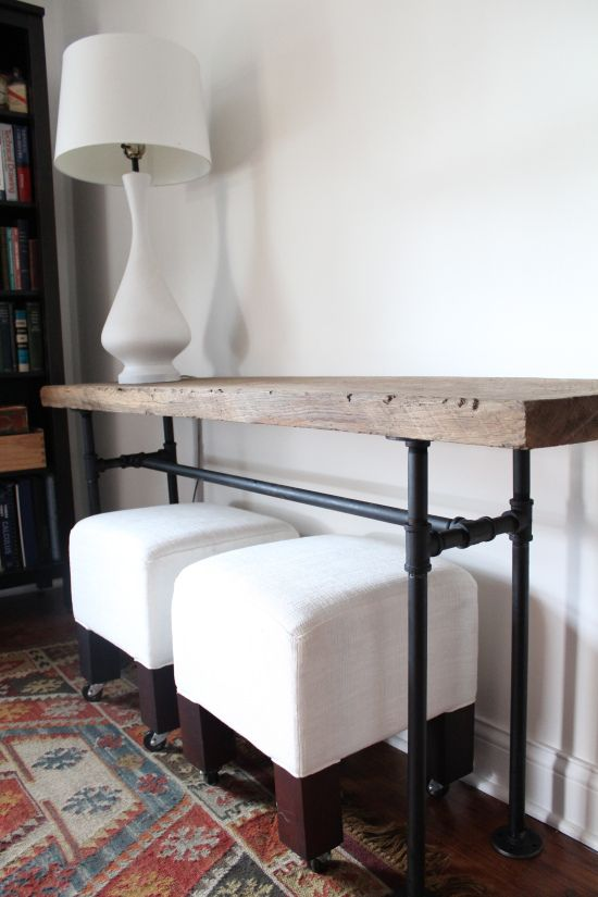 diy black pipe console table- We made a console table out of black pipe and wood salvaged from a barn.