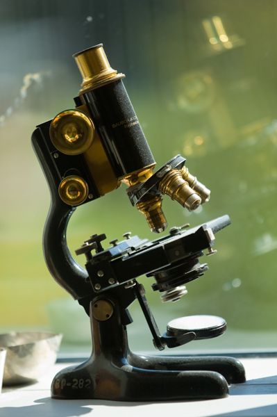 MICROSCOPE - An optical instrument having a magnifying lens or a combination of lenses for inspecting objects too small to be seen or too small to be seen distinctly and in detail by the unaided eye.