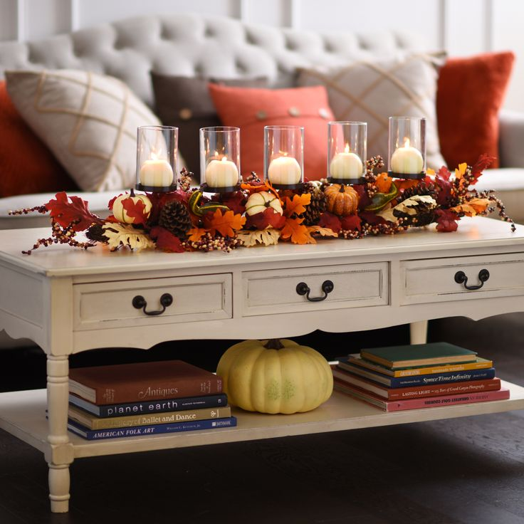 Take your fall decor to new heights with our 5-Pillar Pumpkin Mix Centerpiece. Enjoy warmth from both the candles and the fall colors. Artificial pumpkins, leaves, pinecones, berries, and gourds surround the base of this piece.