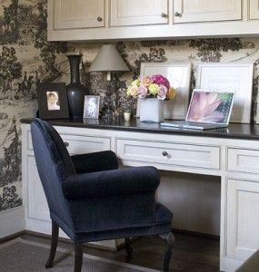 chic wallpaper.  plush chair.