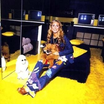 Two fabulous shots of Linda Thompson in her relaxing attire! The TV room at Graceland.