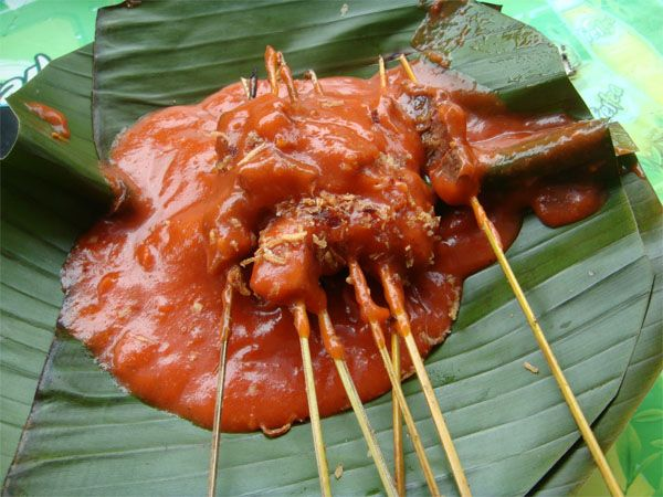 Some Satay Padang's / Sate Padang's gravy looks a bit reddish