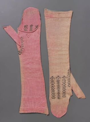Pair of mitts. probably French, late 18th or early 19th century. MFA, 38.1235a-b. Pair of salmon pink knitted silk mitts.