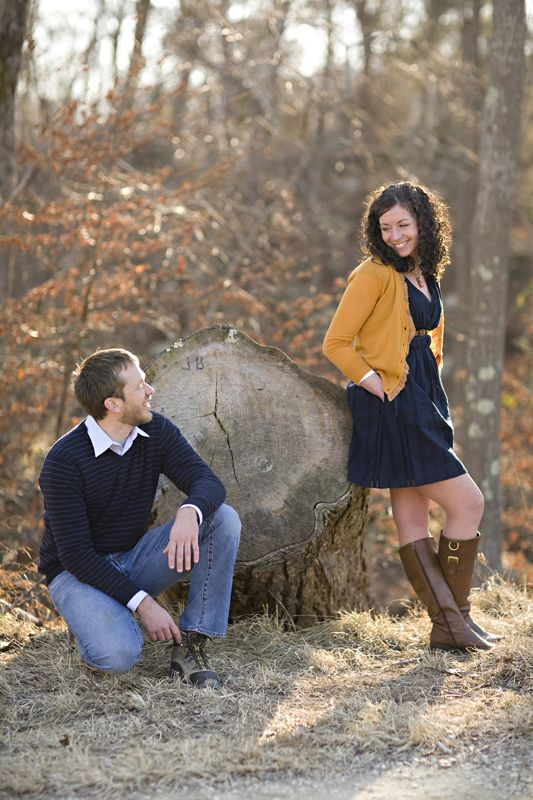 Such a cute engagement picture using nature as a backdrop.  Love the colors the couple is wearing too.