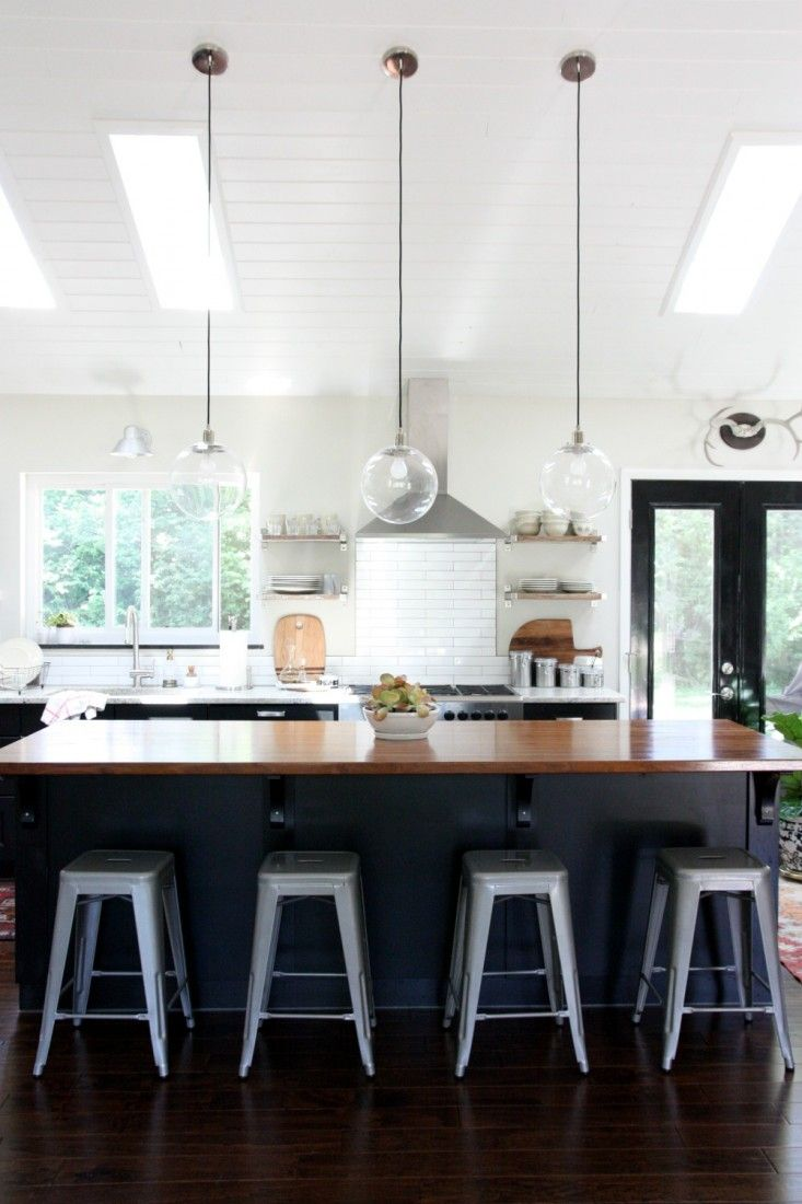 Love the whole look of this kitchen and its open plan design with big island... House Tweaking, Dana Miller's Kitchen, Ikea Black Kitchen Cabinets, Tolix Stools | Remodelista