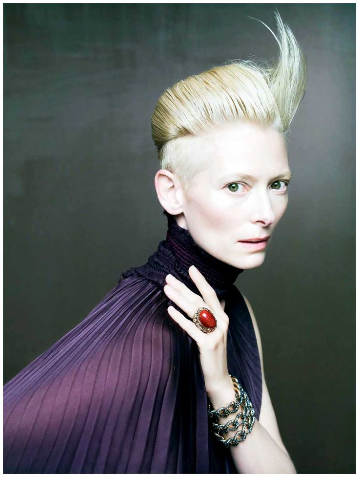 Tilda Swinton photographed by one of my favourite photographers Paolo Reversi. Such great use of colour. The Purple contrast the blondness of her hair, which is then punctuated by the red ring. The hair styling is bold too with a horn like flick up.