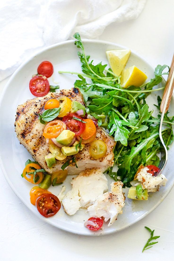 This grilled halibut with tomato avocado salsa is under 400 calories and has only 10 grams of carbs. Proof fish can be a lifesaver when you're trying to be healthy.