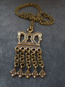 Charlott's Antique Vintage Jewelry - pendent & crosses bronze (Powered by CubeCart) Product Information Bronze pendant from Kalevala Koru ,Finland made in the 40-50´s.The original dates from the time off the Vikings,found in Kalannin Hallun,Finland.