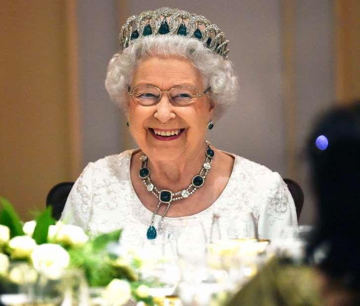Queen Elizabeth II wearing a hat and glasses: Queen Elizabeth at the Commonwealth Heads of State meeting in 2015.