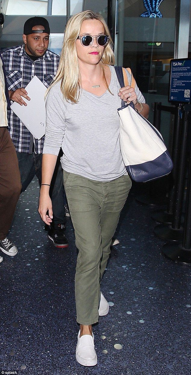 Coming home: Reese Witherspoon arrived at Los Angeles' LAX airport on Saturday with her daughter, Ava Phillippe