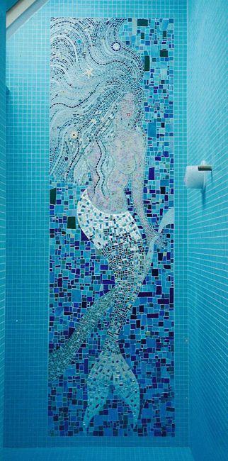 Mermaid mosaic in shower.