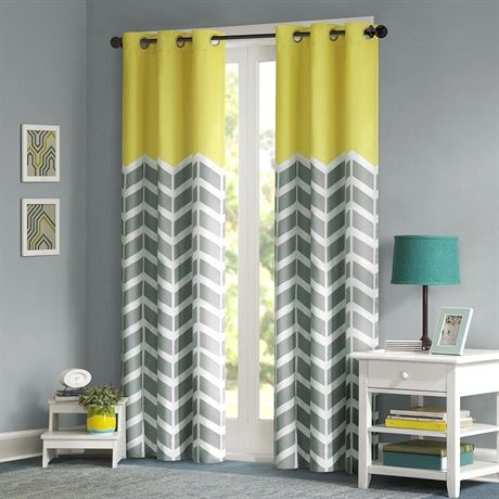 The Nadia window panel makes any bedroom fun and inviting! The panel features a fresh solid yellow color top border with a grey and white chevron print that runs along the bottom broken up by white vertical stripes. The panel features a foam back that offers both superior room darkening and energy efficient.  A grommet top treatment that allows for easy opening and closing of the window panel.