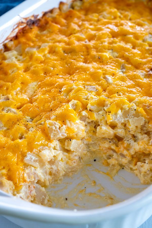 Easy Cheesy Hashbrown Potato Casserole For A Crowd With Sour Cream Onions Cheddar Cheese And C Hash Brown Potato Casserole Hashbrown Breakfast Casserole Food