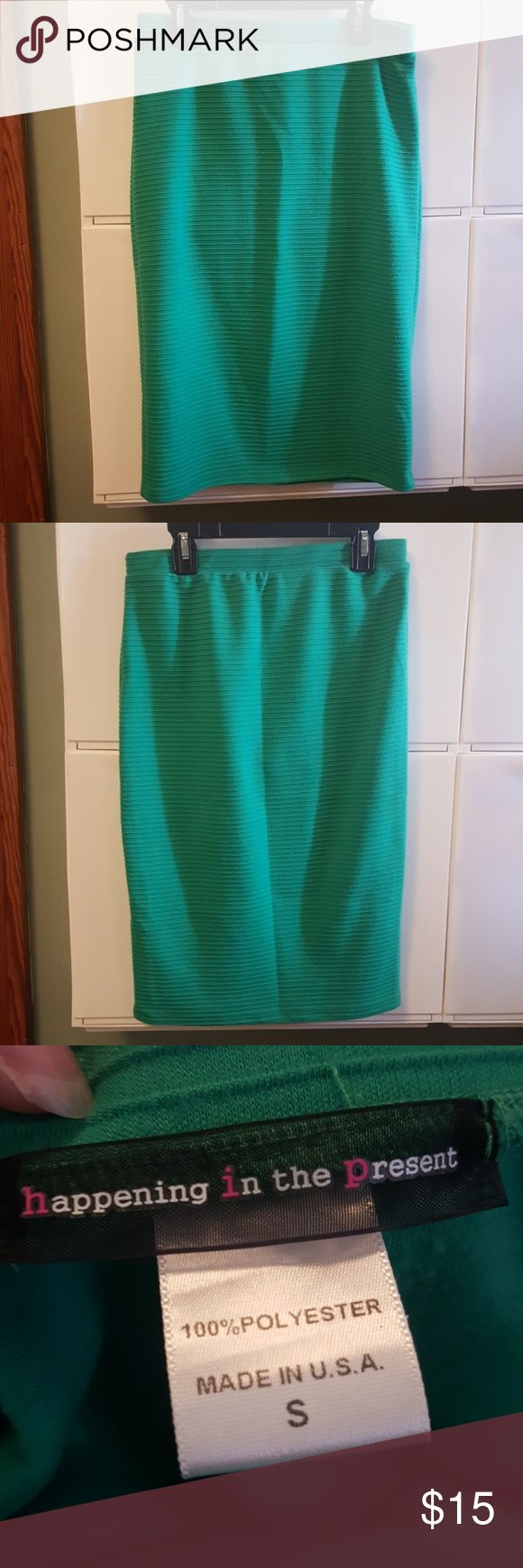 Happening in the present green pencil skirt Good used condition happening in the present green pencil skirt has ridges 100% polyester size small happening in the present Skirts Pencil