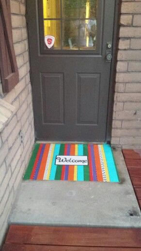 Painted door mat where a regular mat will not work for clearing the opening door. Fashioned after my outdoor pillows and seat cushions!