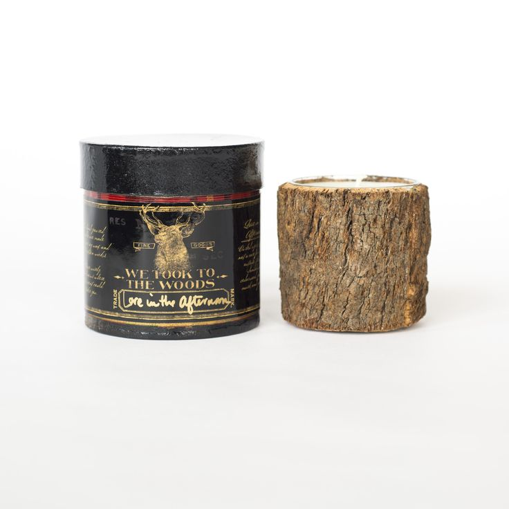 WE TOOK TO THE WOODS SCENTED CANDLE Curled up by the fire, not a care for anything outside the door. Sandalwood, Cedarwood, Patchouli, Musk & Jasmine. Bark candle in black and red tartan packaging.