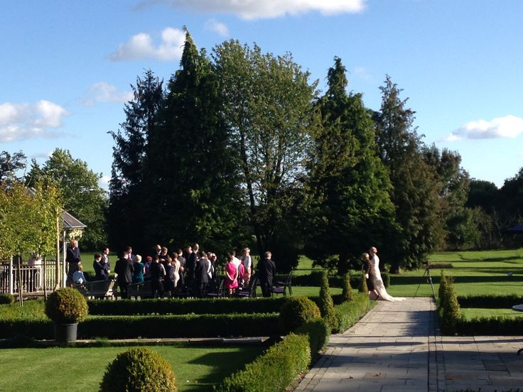 """Louise walking to the bandstand to meet John to say """"I do!"""" at Lemore Manor"""