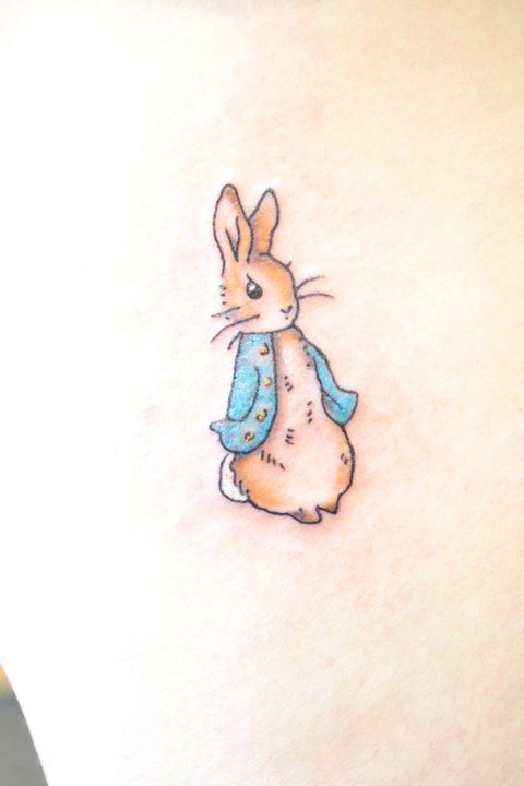 Peter rabbit tattoo (: so cute.  my daughter loves peter rabbit, but i think she likes Benjamin Bunny more.