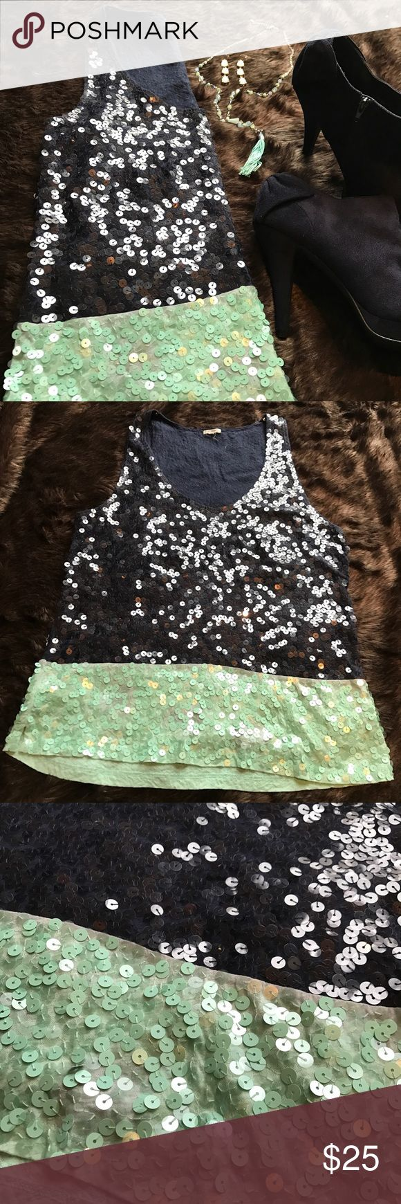 J. Crew Color Block Sequin Tank Top J. Crew Color Block Sequin Tank Top • Size small • 100% cotton with 100% silk trim • Navy blue and Seafoam green color block design • This cotton classic is wrapped in sparkle with opaque and clear sequins covering every inch of fabric • Slim fit that gives way to a flowy bottom with side slits for a fun flirty look • Hand wash • Like New Condition J. Crew Tops Tank Tops