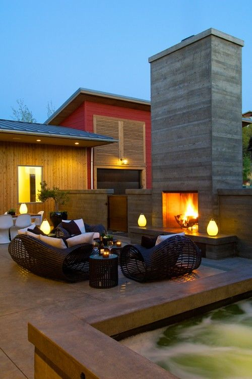 outside fireplace, patio, and hot tub.