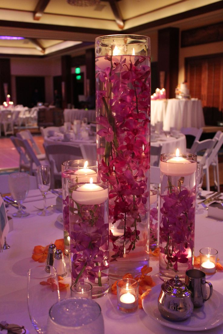 Beautiful orchid flower table setting - Find more of our rentals at www.eventaccents.com