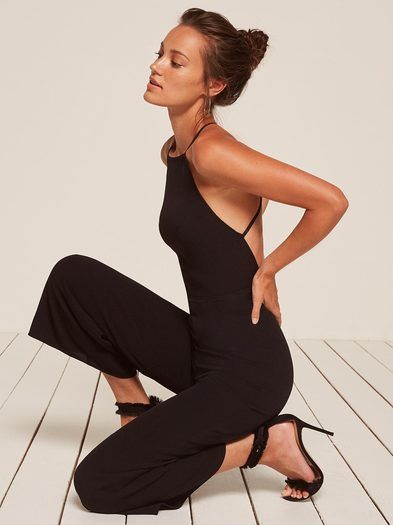 Fancy pants. This is an open back jumpsuit with a straight neck and a wide leg.
