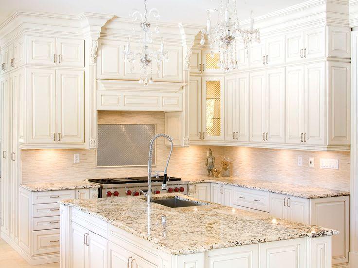 White Kitchen Cabinets With Delicatus Granite Countertops