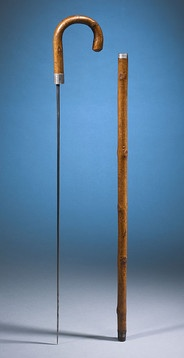 Emperor Bokassa's Sword Cane: This rare walking stick was once owned by Jean-Bédel Bokassa, also known as Bokassa I of Central Africa, one of the most controversial leaders in modern African history. Hewn of bamboo, this modest walking stick actually hides a deadly secret. Simply pull on the handle to reveal the lethal sword blade hidden within the cane's shaft. Crafted of fine steel, the blade's unusual shape makes it difficult to adequately stitch a wound.
