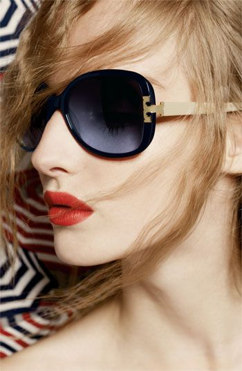 Give your tortoise or black shades a break and opt for these blue/ivory oversized sunglasses from Tory Burch.