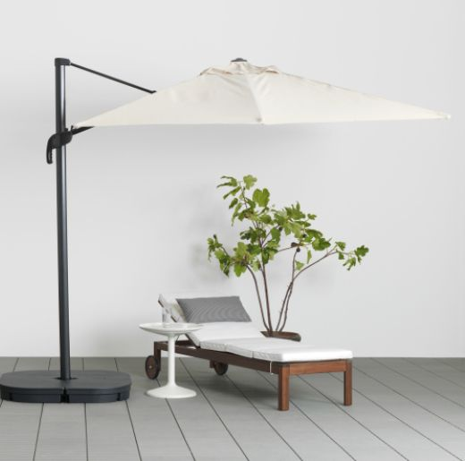 Ikea seglaro hanging outdoor umbrella and svarto base for Ikea outdoor side table