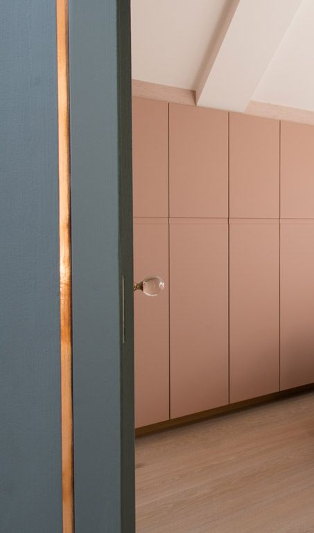 Leather cladded wardrobes. Copper strip in shadow gap. #Orbe for AND Architects