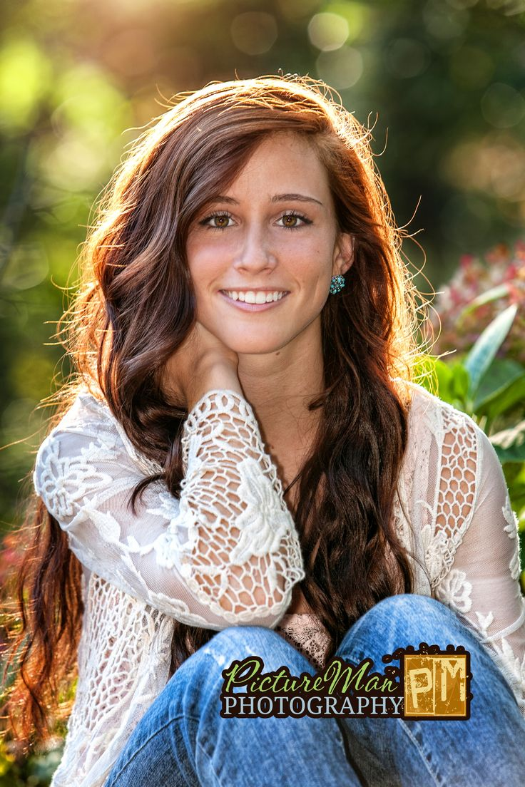 Haley Senior Portrait on stone wall